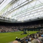 Andy Murray playing on Centre Court during Wimbledon 2013
